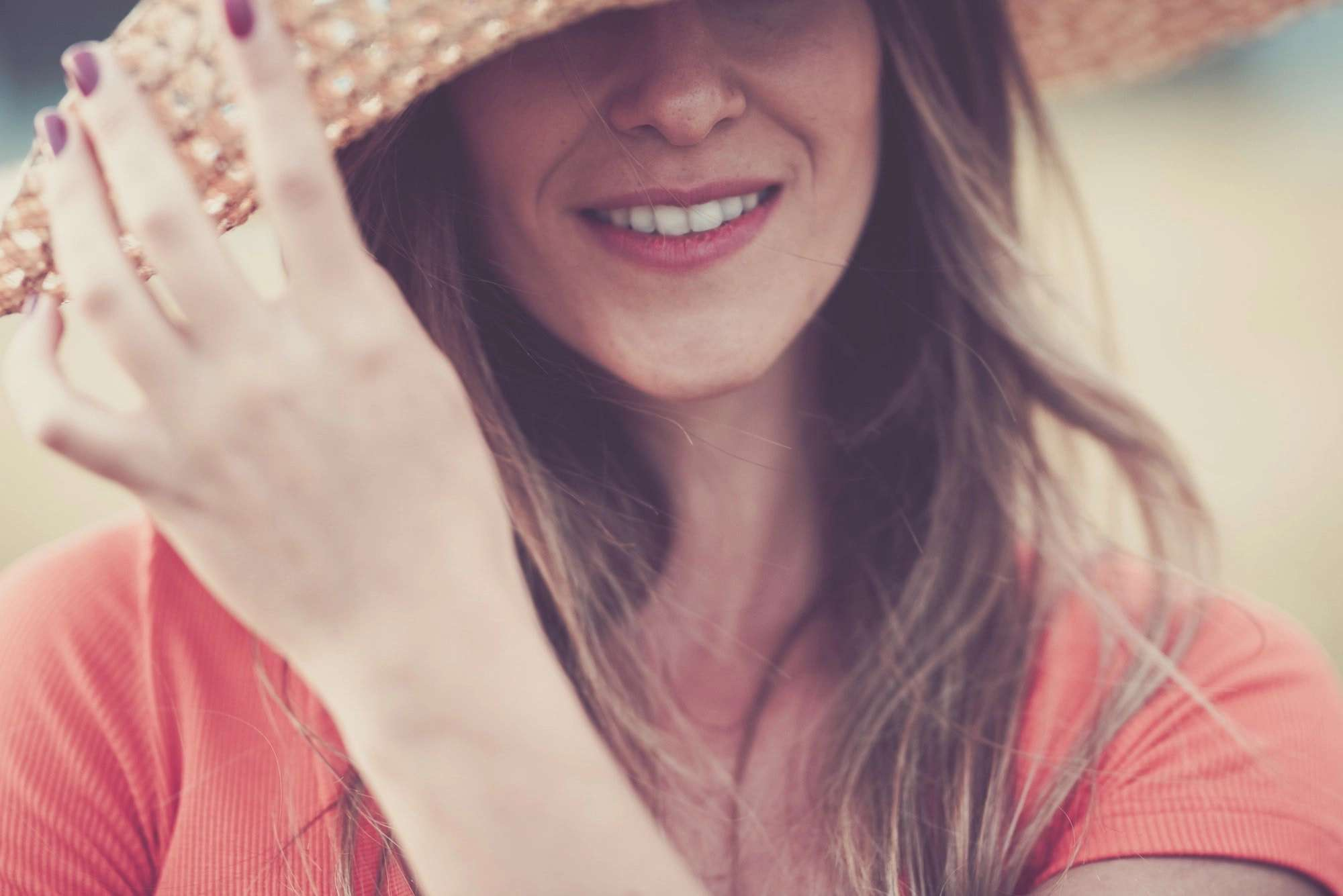 Close up woman portrait in vintage pink tones with cheerful female